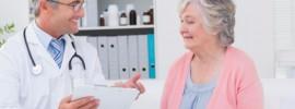 doctor speaking with elderly patient: CannaLinq Cannabis Blog