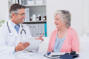 doctor speaking with elderly patient: CannaLinq Cannabis Blog