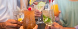 Close up of cocktails toasting: CannaLinq CBD Oil Blog